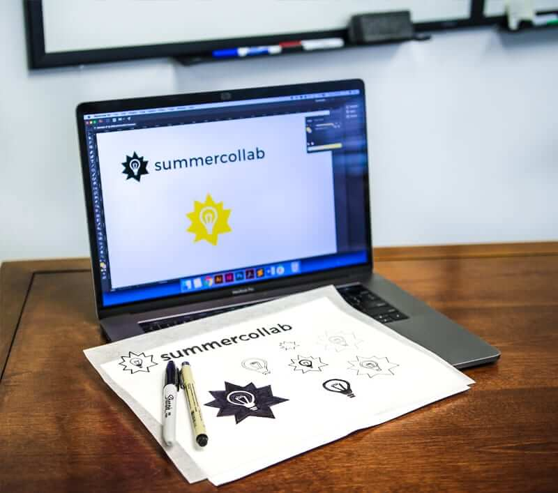 Summercollab sketches and designs shown on the laptop